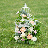 Flower, roses in birdcage shabby chic. Green grass background Stock Photography