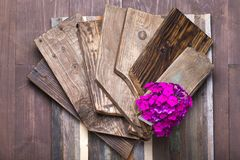 Flower on a rough weathered wooden board. Rustic texture for bac Royalty Free Stock Image