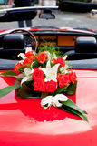 Flower's bouquet on a red car Royalty Free Stock Photography