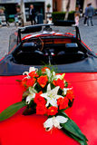 Flower's bouquet on a red car Stock Photo