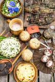 Flower salad, cheese, grilled fish, dessert and bread Royalty Free Stock Photos