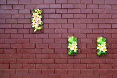 Flower sculpture on brick wall Royalty Free Stock Photos