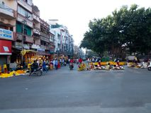 Flower seller at busy Indian Market on Pre diwali morning. Marigold flowers, garlands, earthen lamps, diya, deepak, earthen decorative, puffed rice etc royalty free stock image