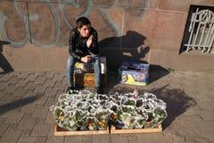 Flower-seller. KHARKIV, UKRAINE - MARCH 8, 2017: Flower-seller during International Women`s Day IWD Royalty Free Stock Images