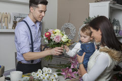 Flower seller with mother and child Stock Images