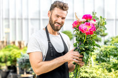 Flower seller in the shop Royalty Free Stock Image
