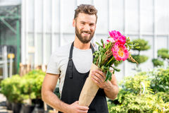 Flower seller in the shop Stock Photos