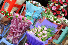 Flower selling at flower shop. Within intersting setting facilities and container Royalty Free Stock Photos