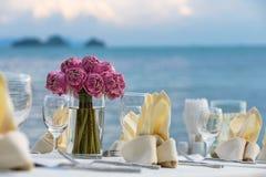 Flower setting. On the beach Stock Photos