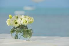 Flower setting on the beach. Wedding flower setting on the beach Stock Photos