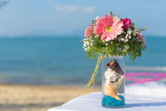 Flower setting. Wedding flower setting on the beach Royalty Free Stock Photography