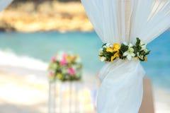 Flower setting. Wedding flower setting on the beach Stock Images