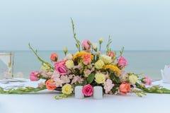 Flower setting. Wedding flower setting on the beach Royalty Free Stock Photos
