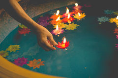 Flower-shaped candle burning in the pool of spirit at chinese te Stock Photo