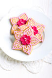 Flower shaped decorated spicy biscuits Royalty Free Stock Image
