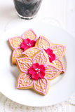 Flower shaped decorated spicy biscuits Royalty Free Stock Images