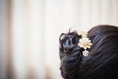 Flower shaped hair pin. To hold hair style stock photo