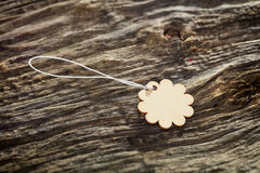Flower shaped wooden tag Royalty Free Stock Photos