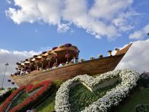 Flower ship. Boat riding over wave of flower Stock Photo