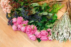 Flower shop background. Fresh roses for bouquet delivery stock photography