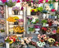 Flower shop, bouquets on shelf, florist business. Beautiful floral decoration royalty free stock photography