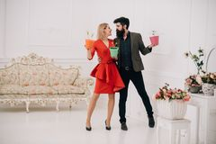Flower shop concept. Sensual woman and bearded man in flower shop. Couple in love in flower shop. Shopping in flower. Flower shop concept. Sensual women and stock image