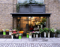 Flower shop. Exterior in street with brickwall facade royalty free stock photos