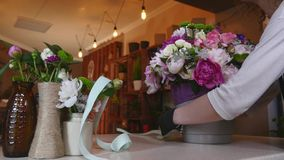 Flower Shop, Florist Arranging Modern Bouquet, Tying Ribbons to Make a Bow, young handsome florists work at flowers shop stock footage
