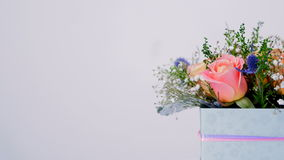 A flower shop offers a variety of flowers and bouquets. Close-up, Flowers, composition, bouquet, rotation on white background, floral composition consists of stock video footage