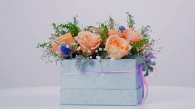 A flower shop offers a variety of flowers and bouquets stock video