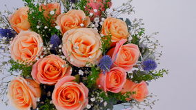A flower shop offers a variety of flowers and bouquets stock video footage