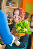 Flower shop owner giving customer flowers Stock Photography
