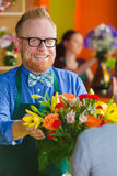 Flower Shop Owner Smiling with Arrangement Stock Photos