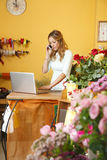 Flower shop owner woman Stock Photo