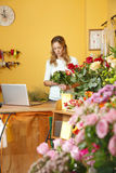 Flower shop owner woman Stock Photos