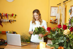 Flower shop owner woman Stock Image