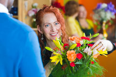 Flower Shop Owner Working on Bouquet Stock Photo