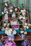 Flower shop, peonies, roses, artificial flowers Stock Photos
