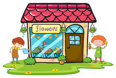 Flower shop with two gardeners working Royalty Free Stock Photo