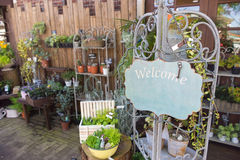 Flower shop with welcome sign and space for text Stock Photo