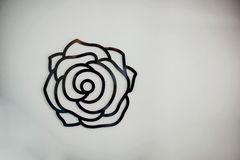 A flower sign over a white wall stock photos