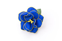 Flower of silk brooch. Isolated stock image