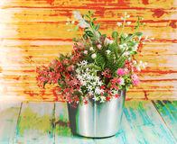 Flower in silver can on rustic wooden ,hard mix technic. Flower in silver can on rustic wooden table,hard mix technic Royalty Free Stock Photo