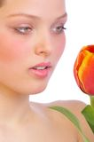 Flower skin. Beautiful face of an attractive young woman