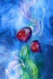 Flower smoke. On blue background Royalty Free Stock Photography