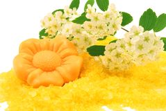 Flower soap over bath salt Stock Photo