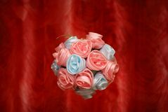 Flower sphere. Sphere from artificial flowers on a red background Stock Photography