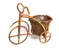 Flower stand in the form of a bicycle made from rattan. Left view Royalty Free Stock Photography