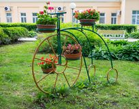 Flower stand in the park made in the form of a bicycle stock photo