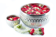 Flower Steering wheel and Water with jusmine and roses corolla i. Thai garland Flowers and Water with jasmine and roses corolla in bowl isolated on white Stock Photo
